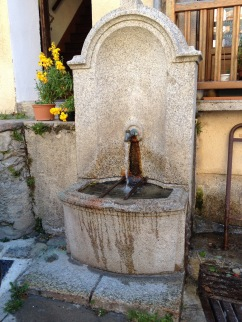 a stone fountain in saint martin vesubie